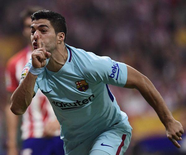 1b9427922 Barcelona s Uruguayan forward Luis Suarez celebrates a goal during the  Spanish league football match Club Atletico