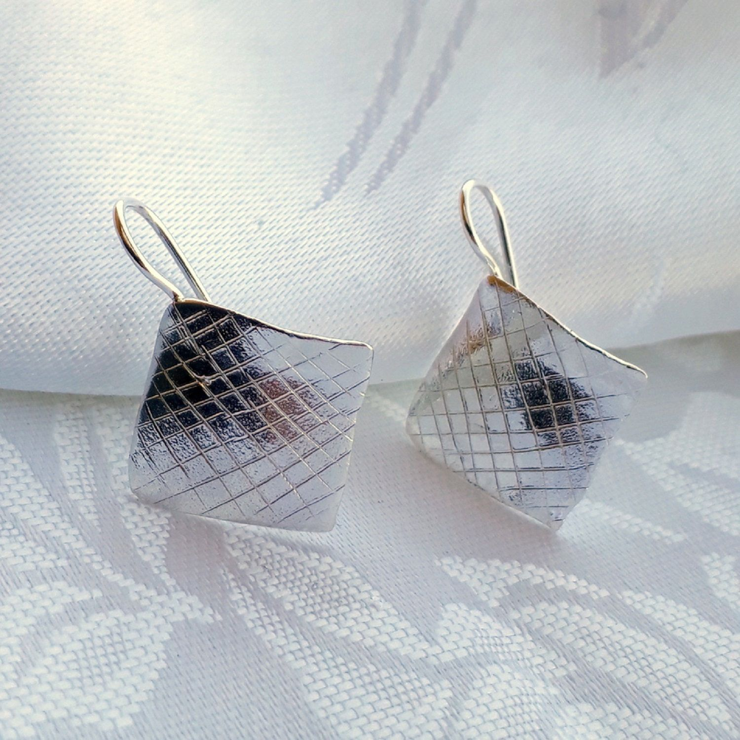Square and silver-leaf earrings