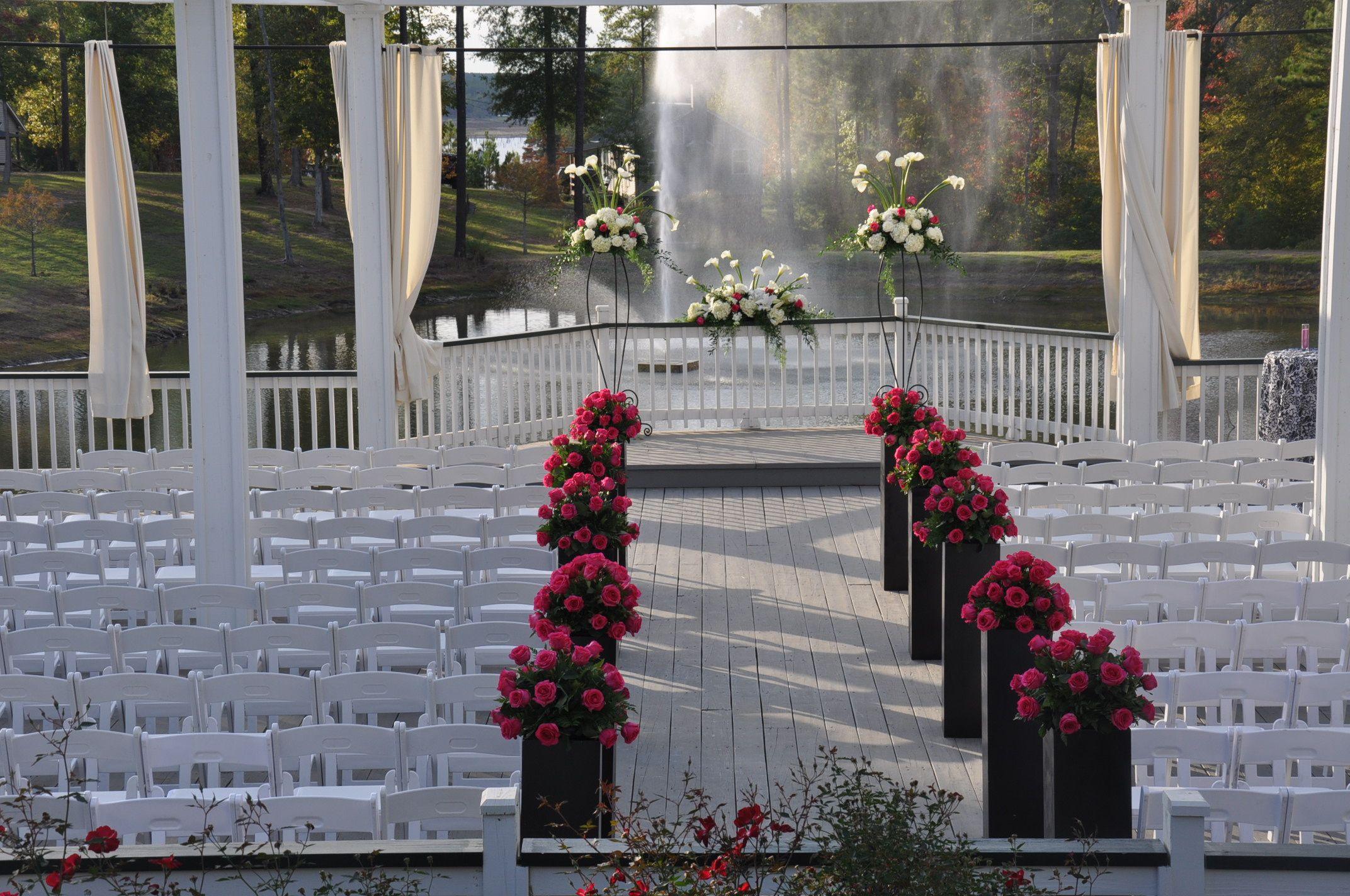 Outdoor wedding on wildwood deck overlooking pond
