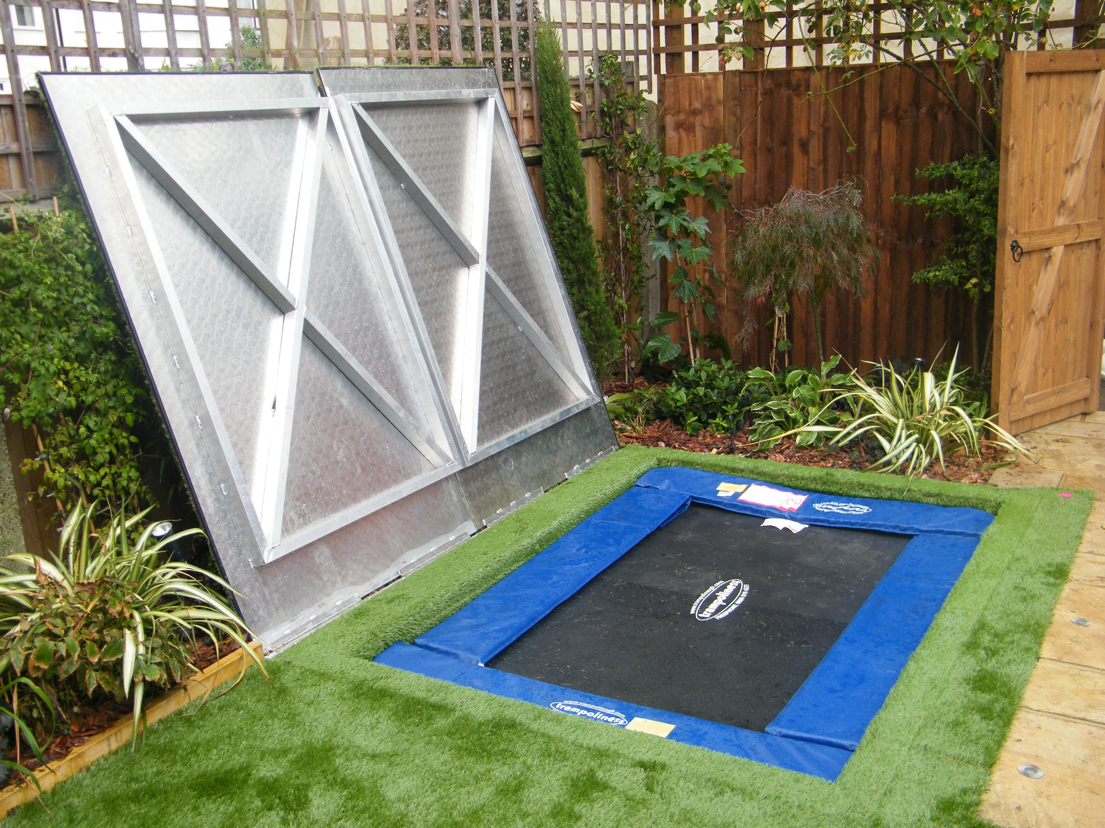 small garden in dulwich with a bespoke cover over the sunken trampoline thus making the lawn small trampolinebackyard trampolinetrampoline ideaskid - Small Garden Ideas Kids