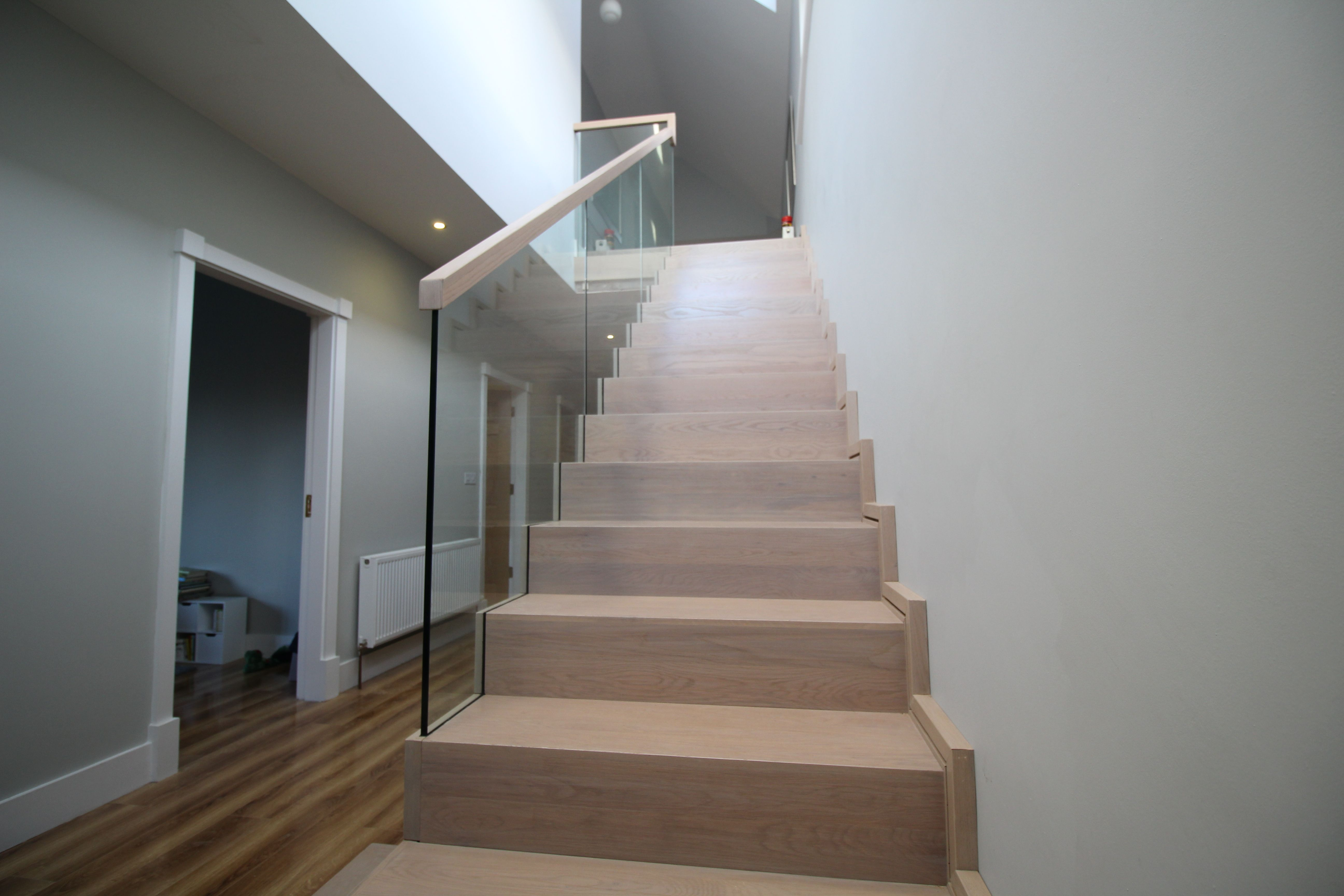 This staircase has an almost floating step effect with open rise steps and off set