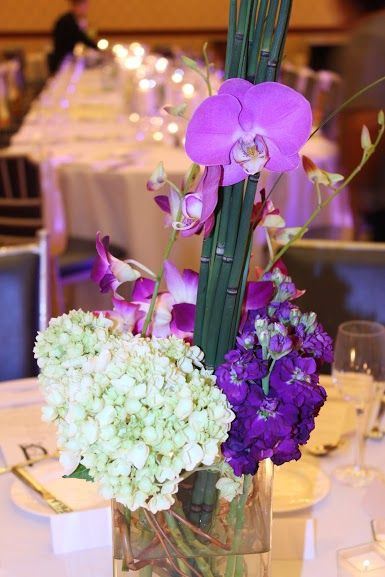 A purple and green Centerpiece featuring orchids, hydrangea, stock ...