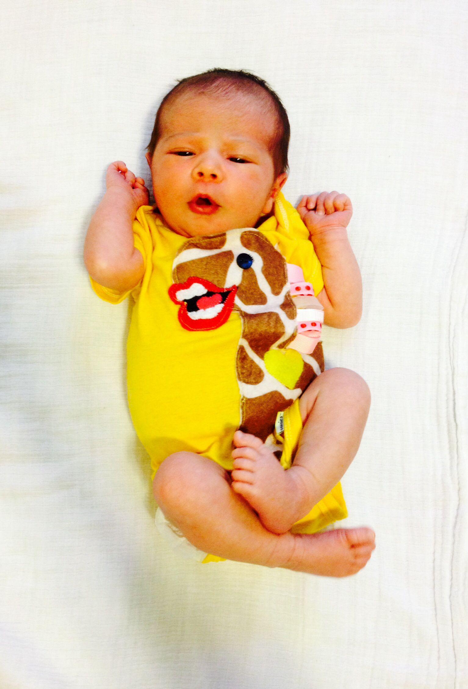 Hand-dyed and handmade giraffe yellow onesie