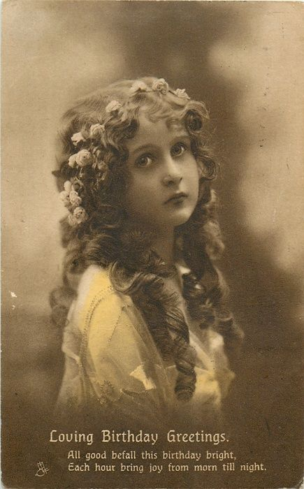 LOVING BIRTHDAY GREETINGS girl with flowers in hair, long curls in front, faces right, looks up: