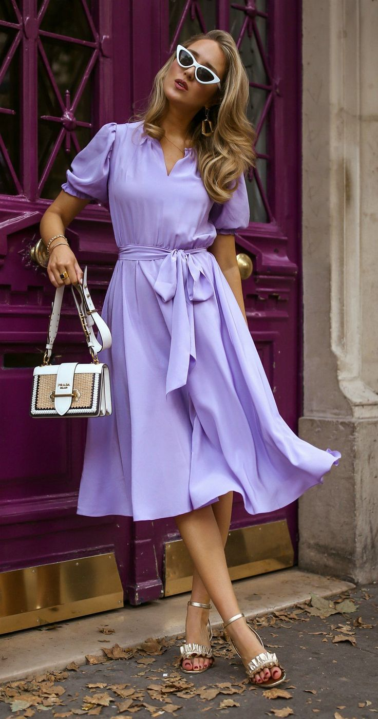 Lilac: Not Just For Summer Style // Lilac puff sleeve silk tie-waist dress and circle skirt, classic parisian style, retro cat-eye sunglasses, leather + woven straw bag, statement earrings, {Prada, Le Specs, Baublebar} #parisianstyle