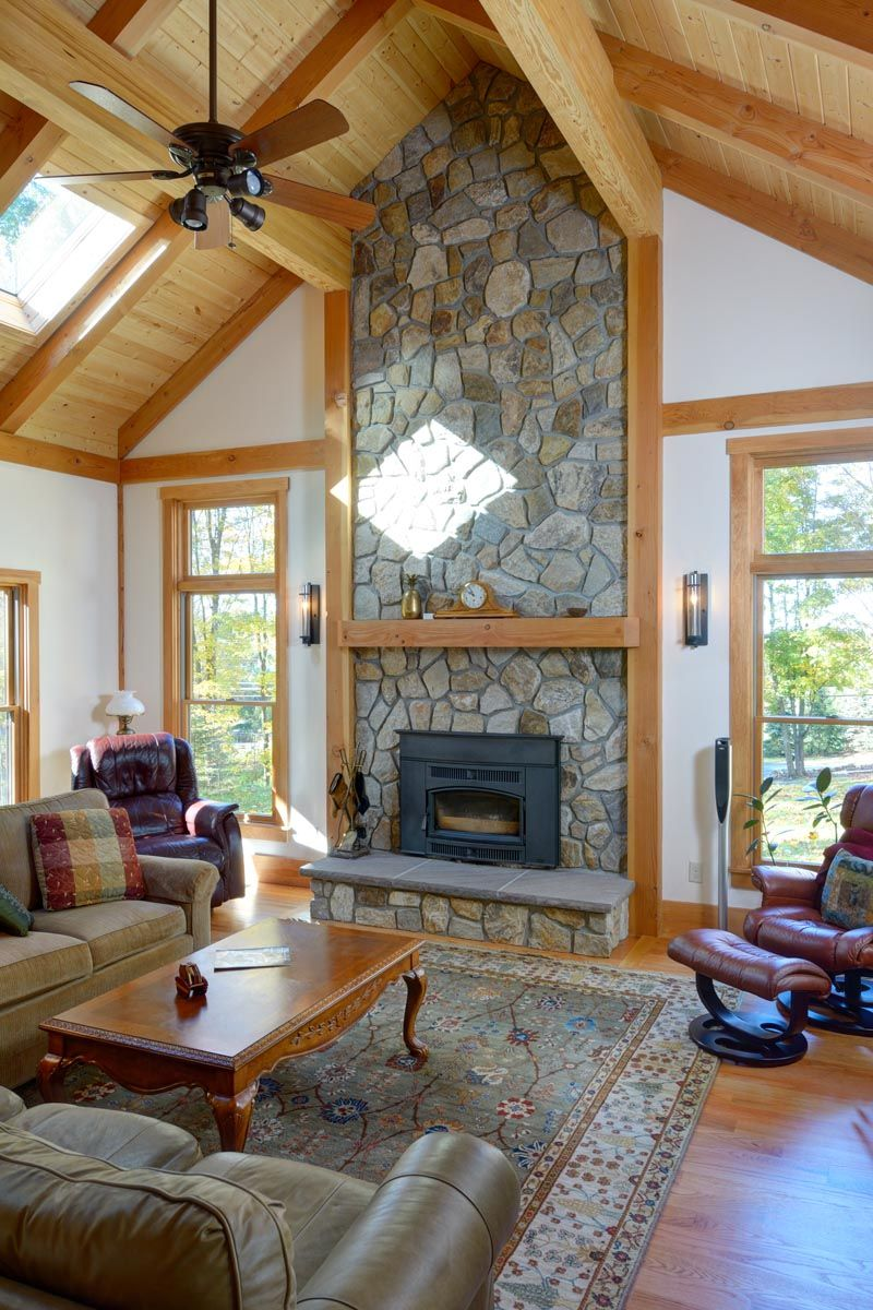 family room with vaulted ceiling and stone fireplace the stone