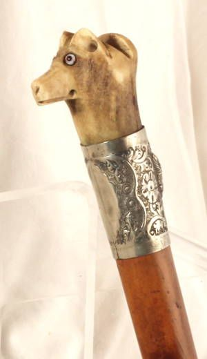 Antique Dog Handled Beagling whip with confused facial expression