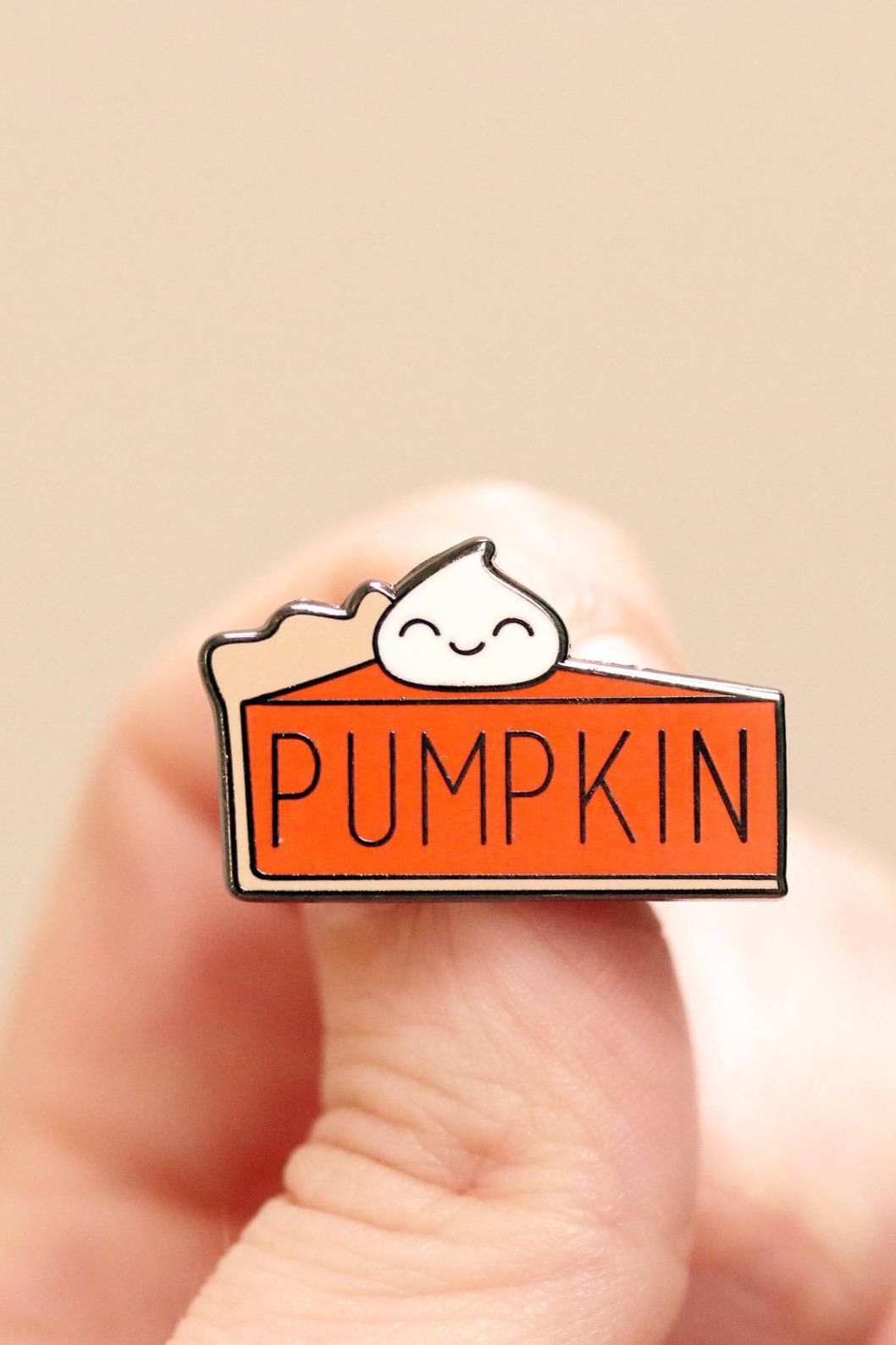 What's Thanksgiving without a little pumpkin pie? This adorable pumpkin pie enamel pie is the perfect addition to your fall pin collection. Add to your fall jacket or bag for a fun seasonal accessory.
