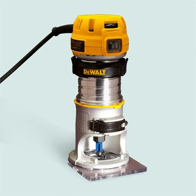 Toh tested trim routers dewalt tools router table and router bits dewalt dwp611 the tool is also available in a 250 kit with a plunge base keyboard keysfo Choice Image
