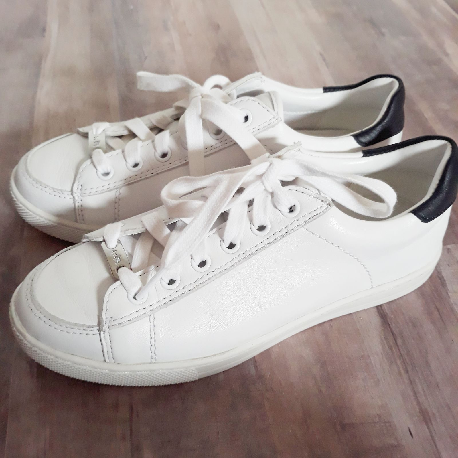 White Leather Tennis Shoes By Coach. Features Black Heels