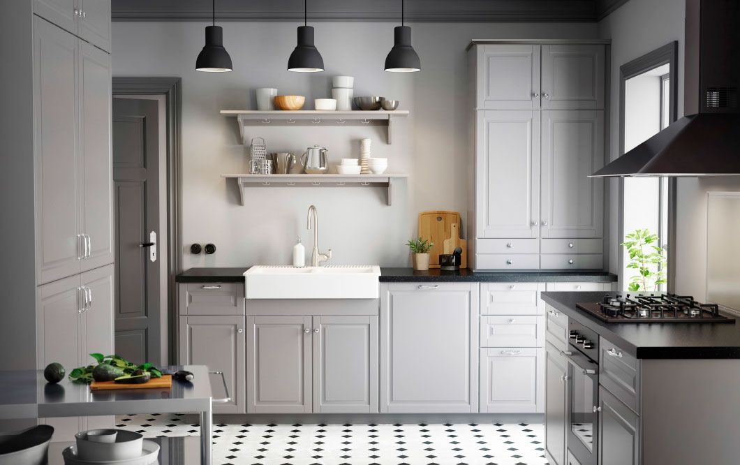 A country kitchen with grey inset doors