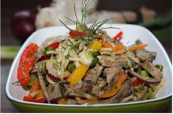 Salad with chicken and pickled mushrooms