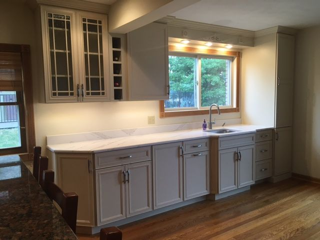A Wet Bar Of Omega Cabinets With Cambria Quot Brittanica