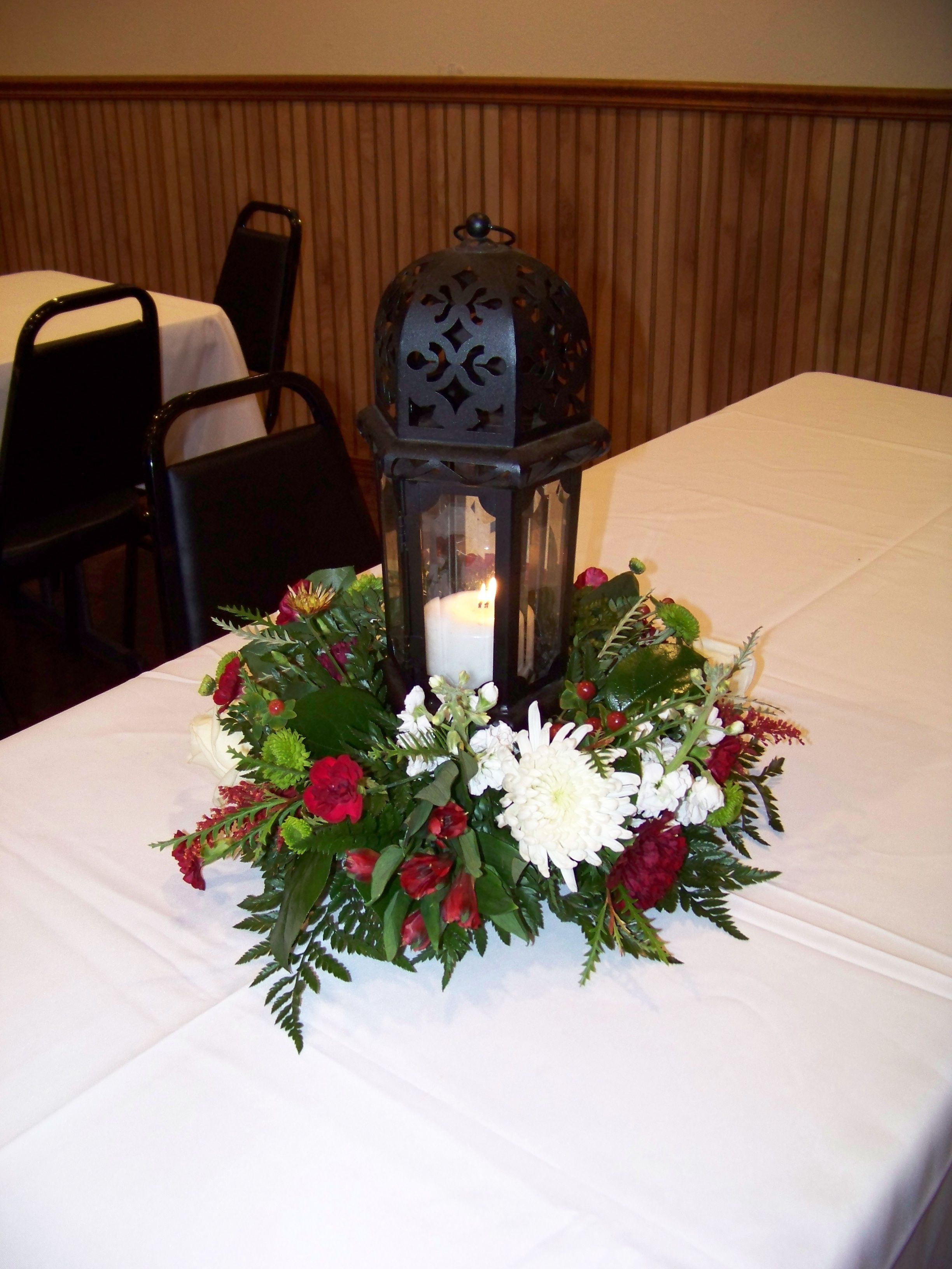 centerpieces wreaths around lanterns or candles flowers for the rh pinterest com
