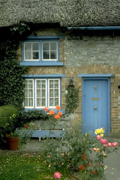 Lovely little cottage with a blue door and trim