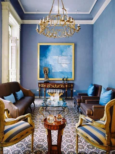 Your frame choice can help you balance your room from one side to the other. In this case the gold frame balances the far end of the room with the yellow in the chairs on the opposite side