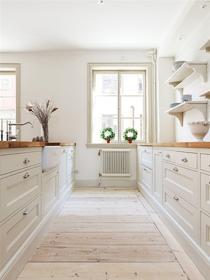 Timeless white kitchen with warm wood countertops a look for Warm kitchen flooring