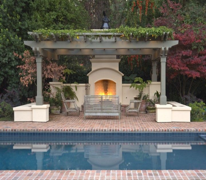 Make an adorable fireplace in pergola deck for coming for Pool with fireplace