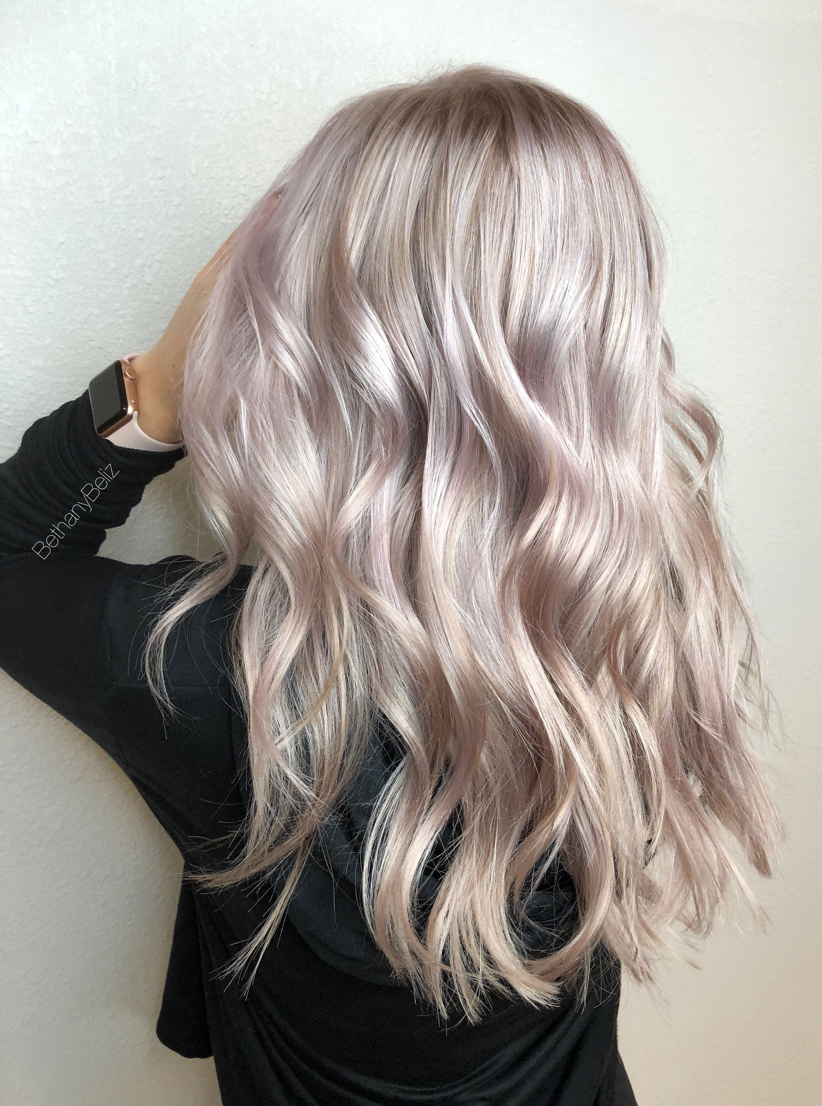 Platinum highlights with a lilac glaze and long layers by Bethany