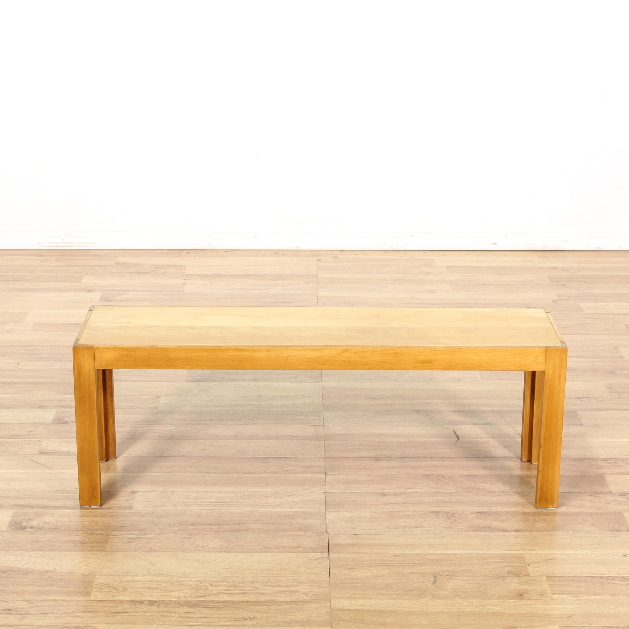 This mid century modern coffee table is featured in a solid wood