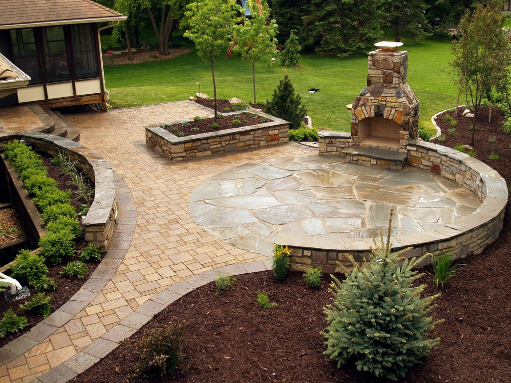 Stone fireplace and NY Bluestone flagstone paver patio with