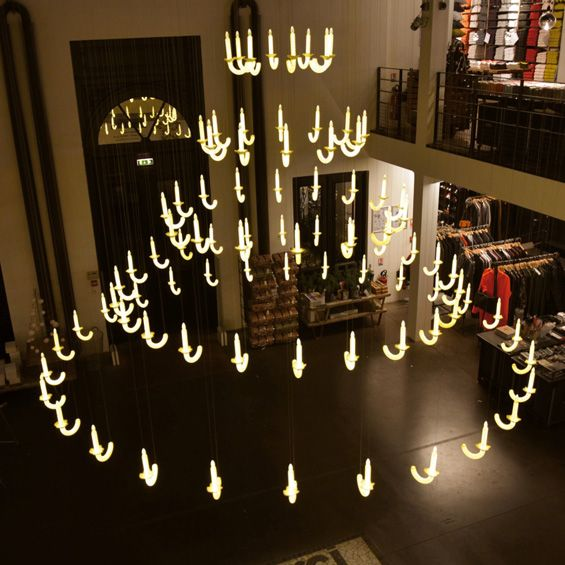 Louis xiv inspired floating chandelier made of 91 porcelain louis xiv inspired floating chandelier made of 91 porcelain candles mozeypictures Image collections