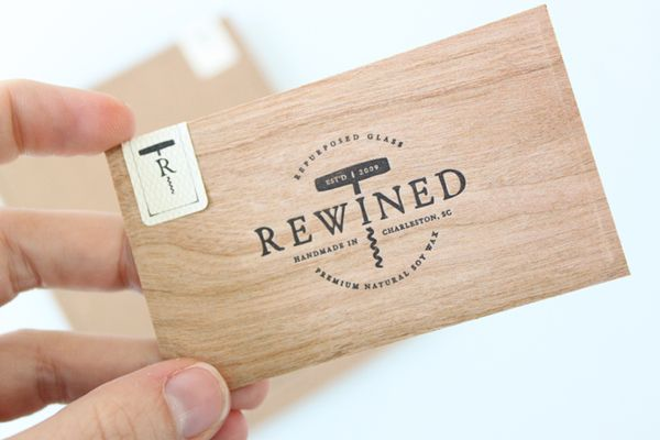 New brand identity for rewined by stitch bpo business cards wood veneer and unbleached paper duplex business card with sticker detail for candle in a wine bottle brand rewined designed by stitch colourmoves