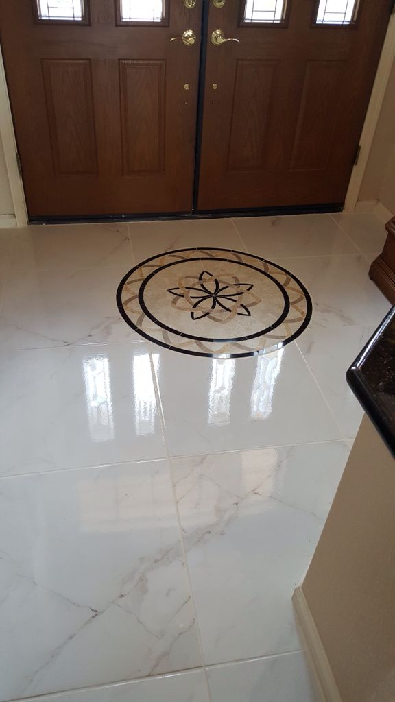 Ceramic 24x24 Tile That Looks Like Carrera Marble With A 36 Round