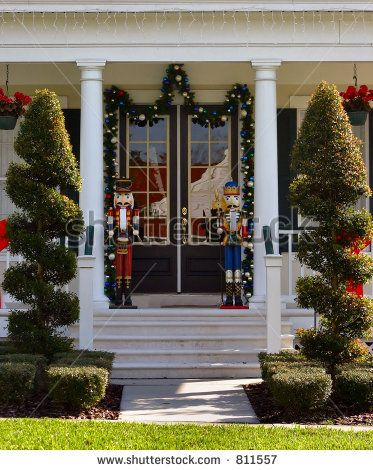 stock-photo-toy-soldier-christmas-decoration-on-front-porch-with-topiearies-811557.jpg (373×470)
