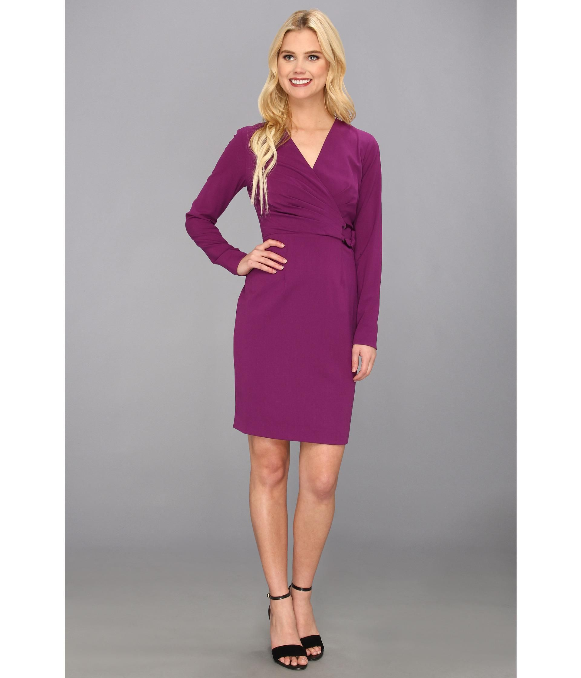 Classic shift dress features figureflattering pleating at surplice