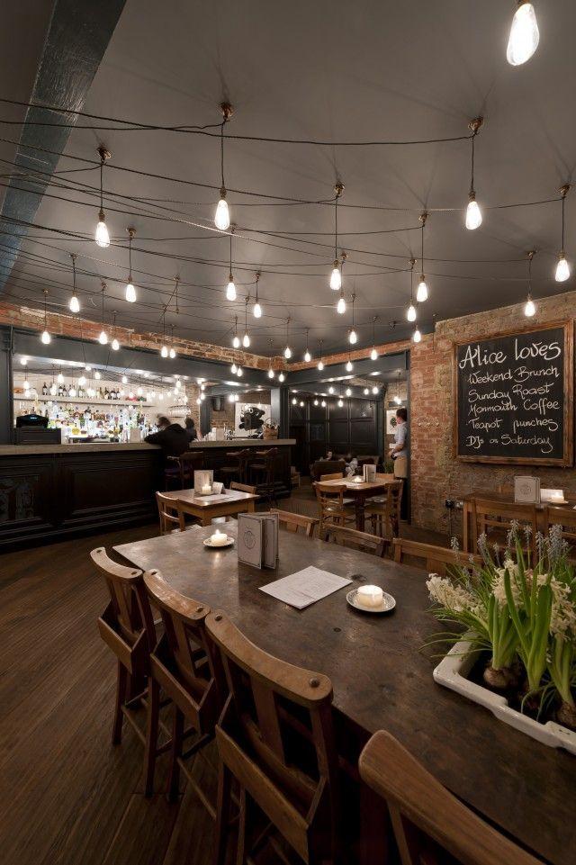 the dark walls and the dark wood floor give it a restaurant lightingrestaurant - Light Hardwood Restaurant Decoration