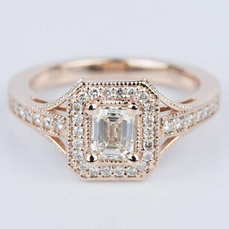 How beautiful is this Vintage Milgrain Emerald Halo Diamond Ring in Rose Gold? We know you are going to love it!