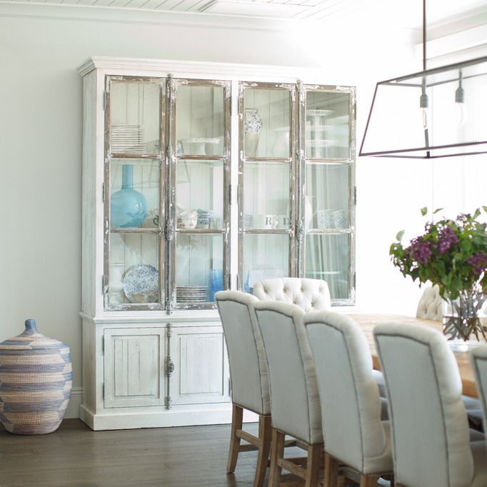 Stunning Dining Room Features Iron And Glass Lantern