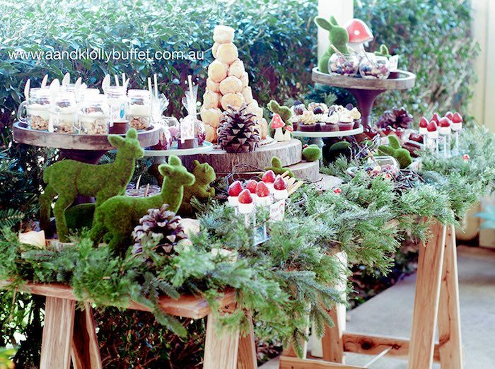 gorgeous woodland sweet table from a woodland forest baby shower via