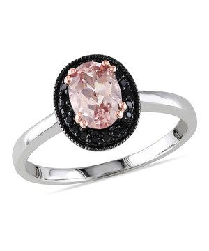If diamonds are a girl's best friend, then this ring is certainly a pal. Sparkling with a morganite gem and dreamy black versions of the famous stone, it makes a dazzling companion to any hand.