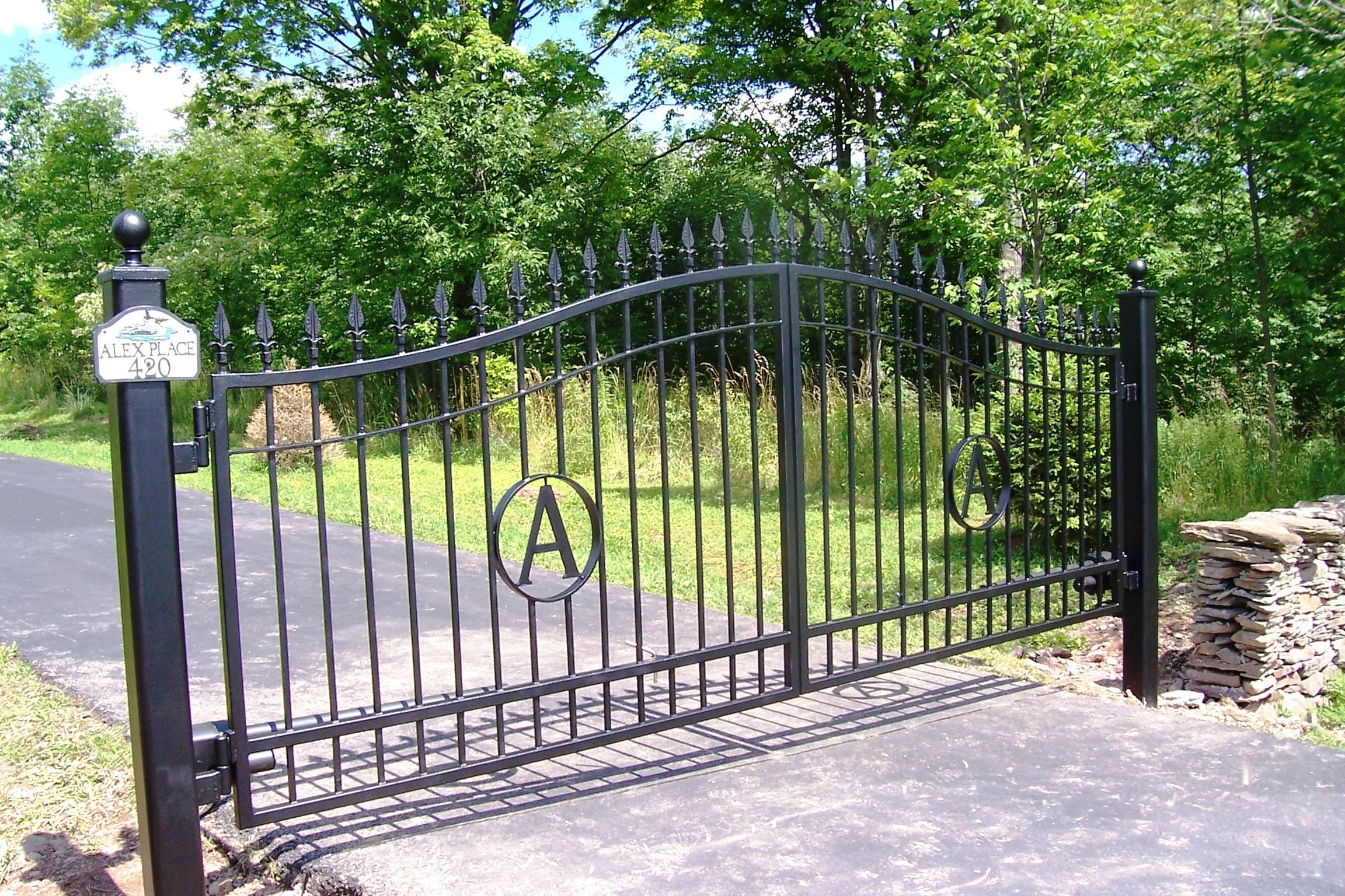 Automated wrought iron estate style gate with initials for Garage fence