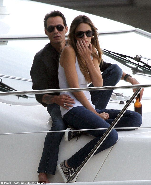 All aboard the love boat: Marc Anthony cuddles up to stunning girlfriend Shannon  De Lima on Miami cruise
