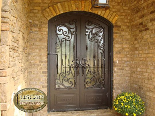 Single wrought iron tuscan doors iron front doors give for Fancy front doors