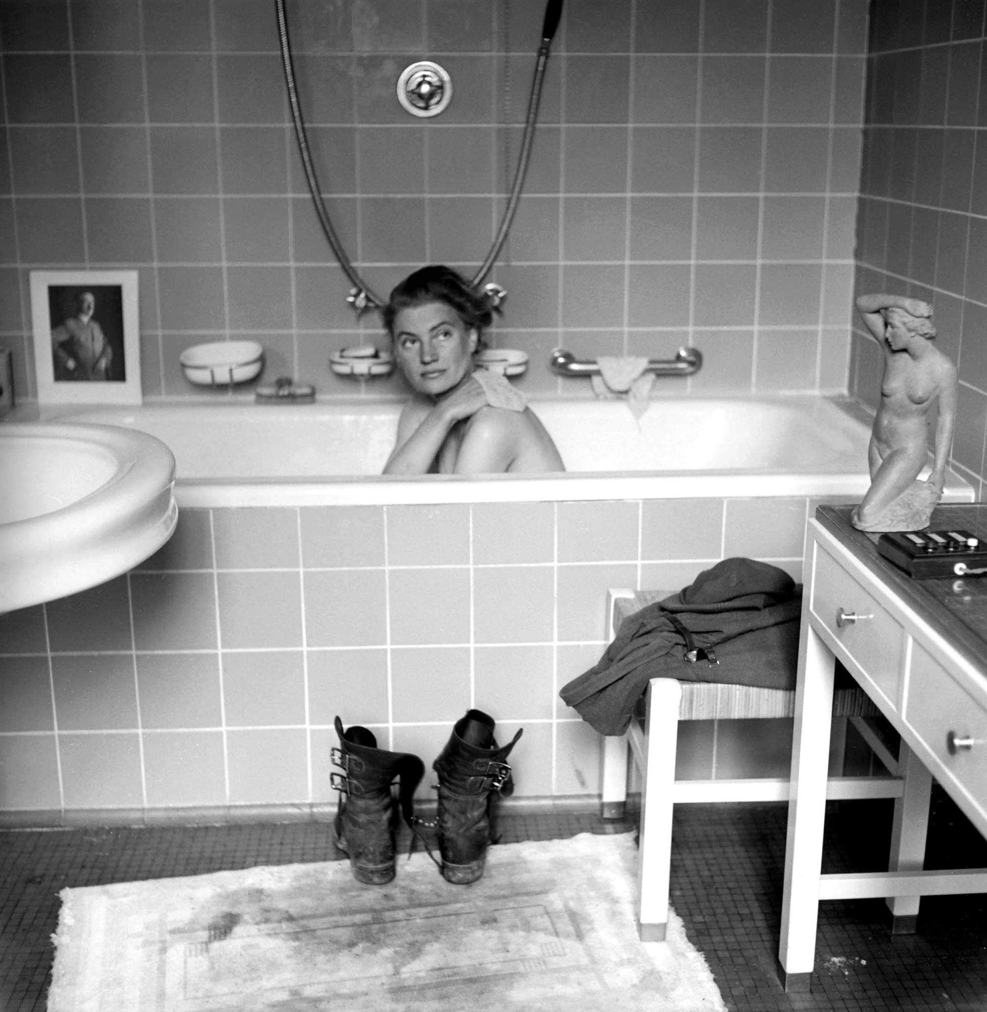 Lee Miller: The Woman in Hitler's Bathtub, Munich, 1945 Lee Miller's life was as extraordinary as her photos. A Twenties fashion model who became a Surrealist and later the only female combat photographer in Europe during the war, she documented the liberation of Dachau and Buchenwald concentration camps. She later married the Surrealist artist Roland Penrose, but became an alcoholic, depressive and sometimes spitefully cruel mother