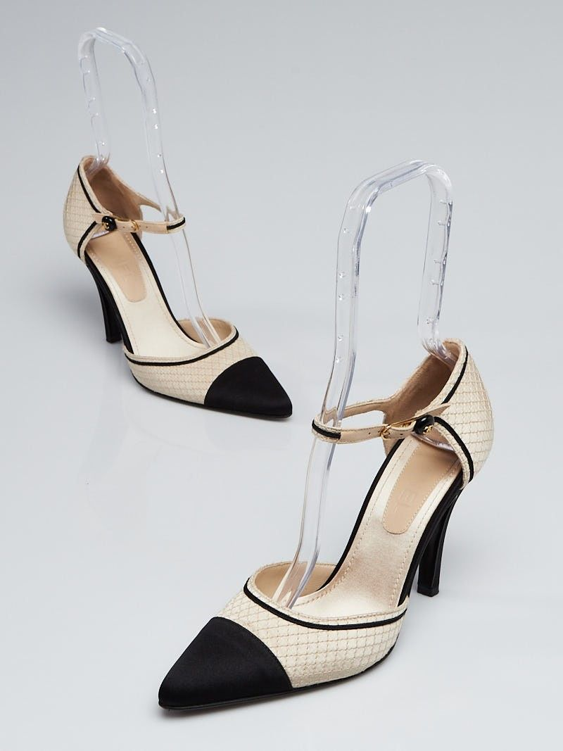 67efec25676 These stylish Chanel Black Fabric Cap Toe Mary-Jane Heels will be an  instant favorite in your wardrobe. These Mary-janes have a black cap-toe  and ankle ...
