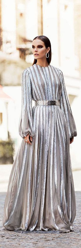 This gown is absolutely perfect.  The metallic silver stripes with a matching belt provide enough bling where accessories are unnecessary. The sleeves give this gown a royal feel.  Choose wisely when it comes to a selecting a shayla.  A shimmery headscarf could be overkill while a multi-colored one could ruin your look altogether. - Habiba West
