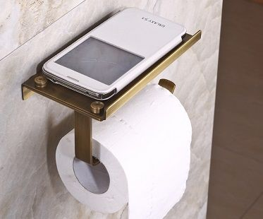 I like this toilet roll holder with shelf but it would mean constant tissue replacement.