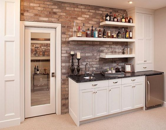 Charmant Elegant Home Bar With A Brick Wall Backdrop And Simple Floating Shelves