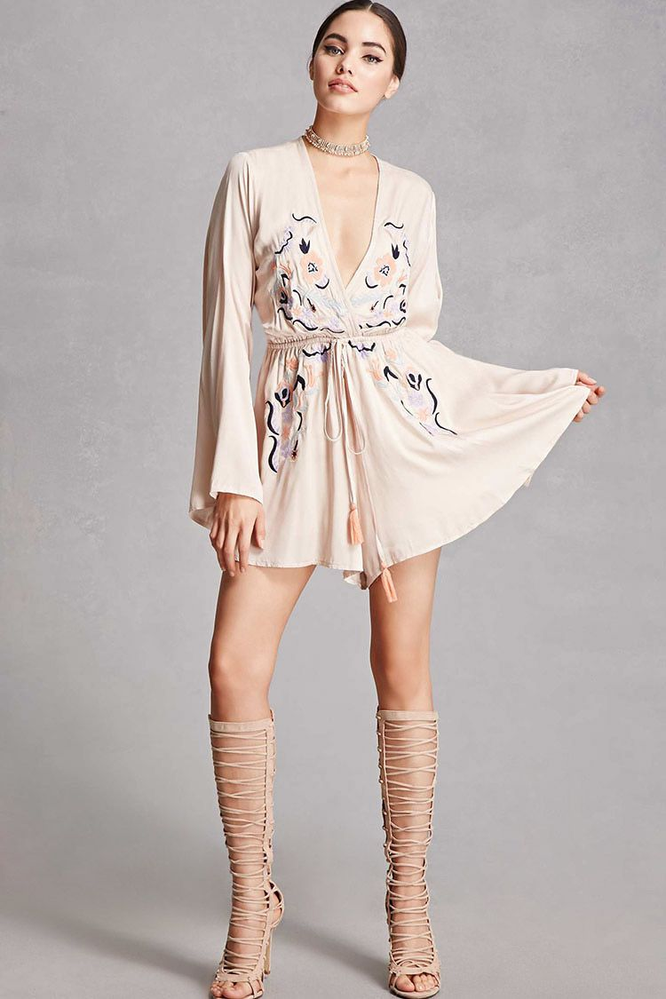A woven romper by selfie leslieutrade featuring a floral embroidery