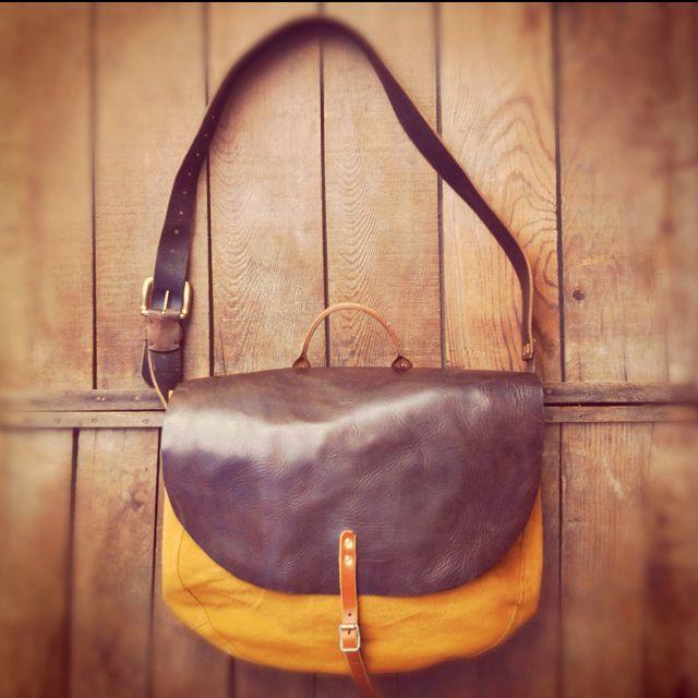 Leather top medium messenger bag.