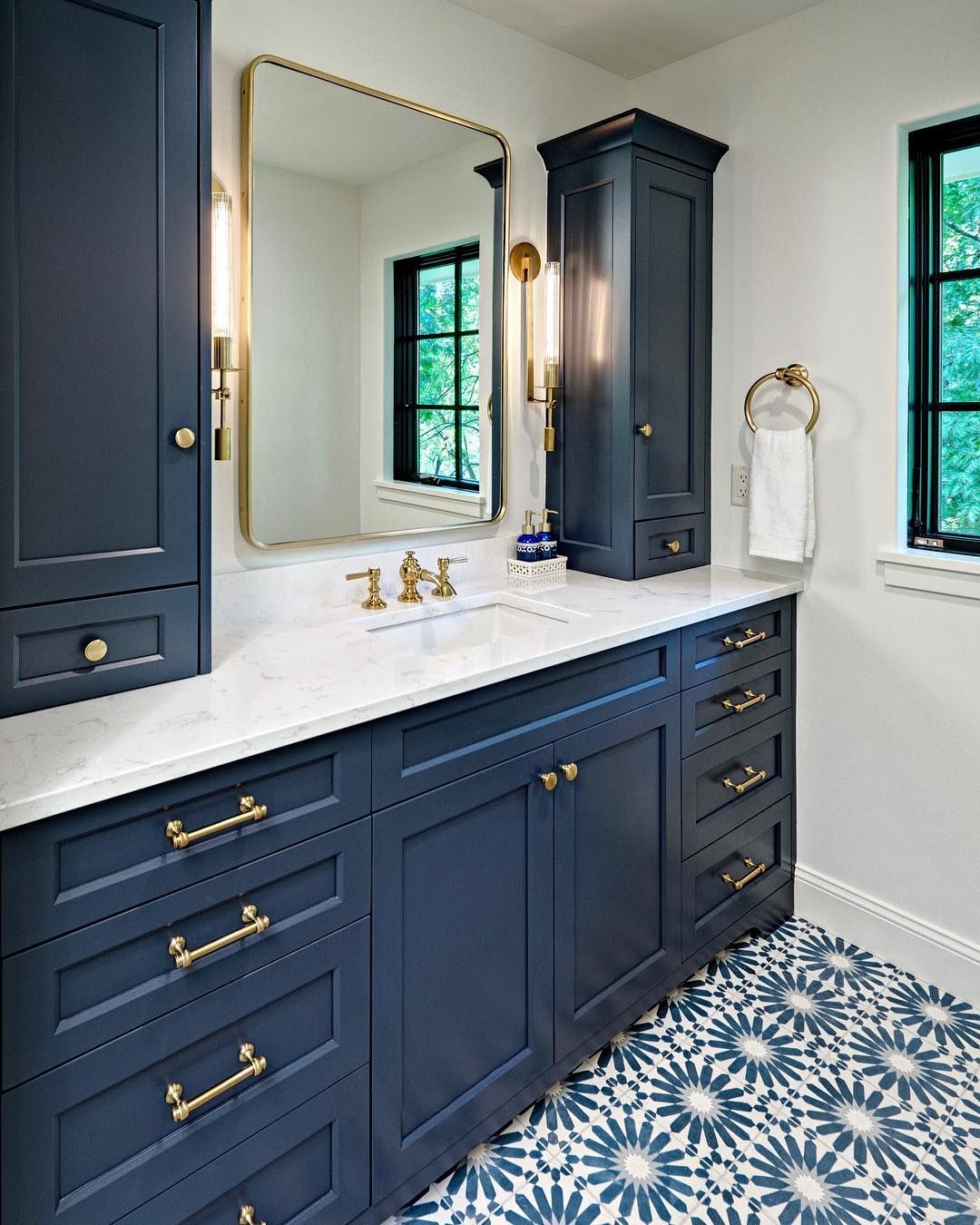 Dreaming Of Blue Hues This Remodeled Blue And Gold Bathroom With Patterned Tile From Boyer Building Corp Is Ab Gold Bathroom Amazing Bathroom Remodels Remodel
