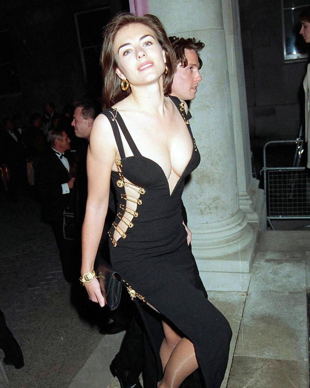 Elizabeth Hurley Wearing That Black Dress To The Premiere Of Four Weddings And A Funeral With Then Boyfriend Hu Hurley Dress Elizabeth Hurley Versace Dress