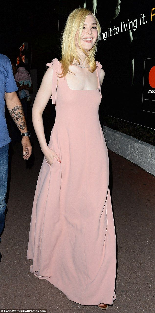 Beaming Elle Fanning is caught off guard at Cannes Film Festival ...