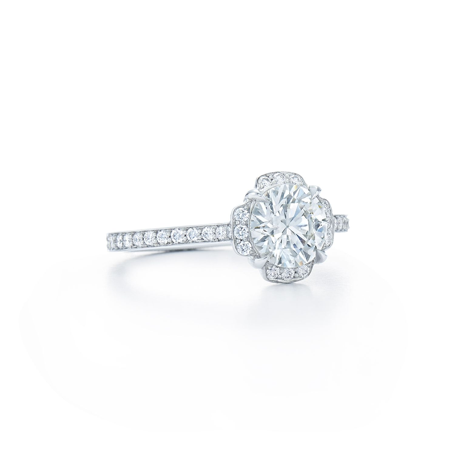 Round brilliant diamond ring with pave diamond halo and band set in