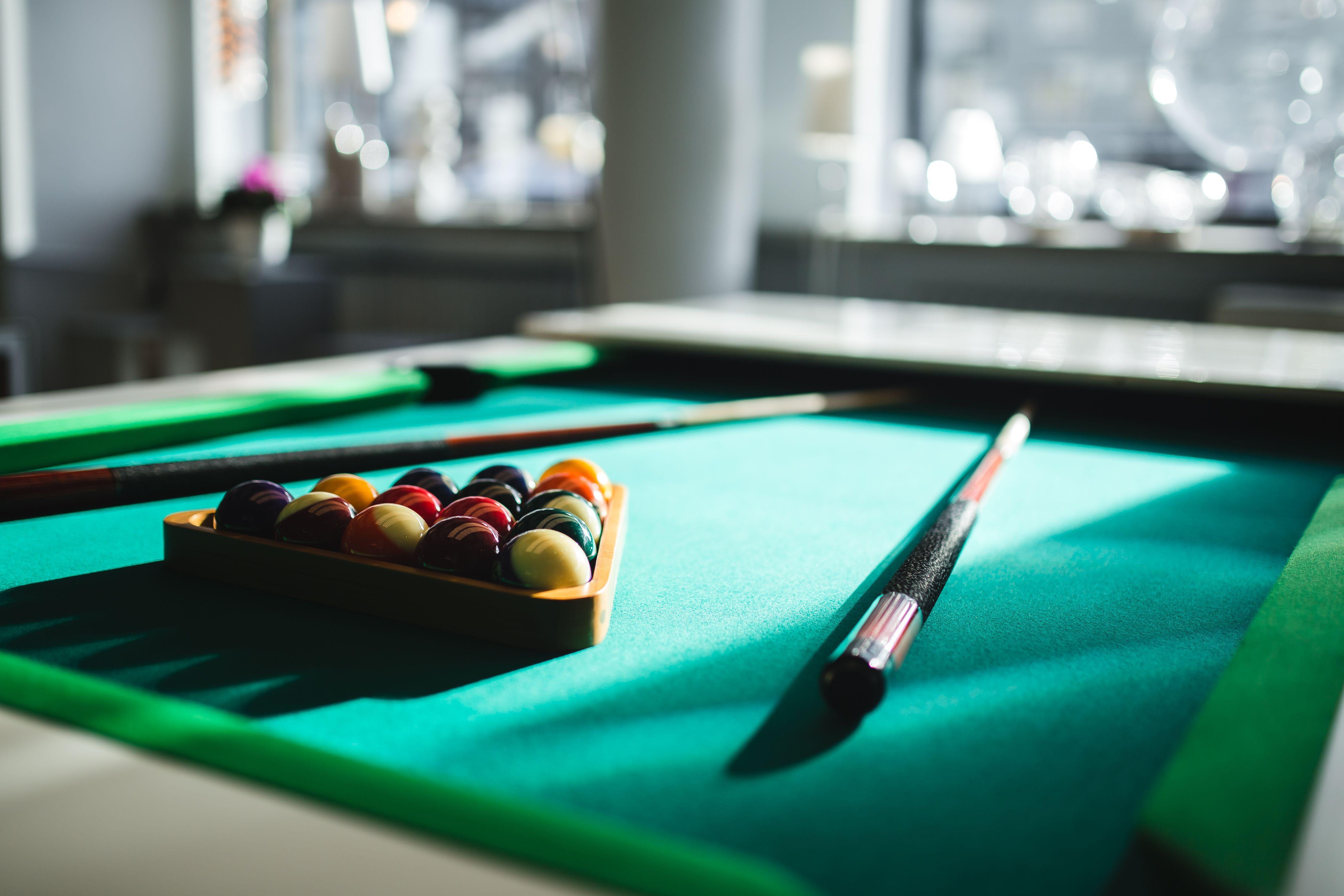Billiard balls on green table with billiard cue Billiard